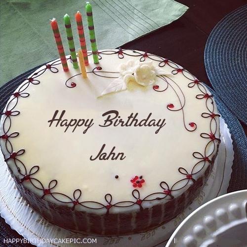 Superb Candles Decorated Happy Birthday Cake For John Funny Birthday Cards Online Kookostrdamsfinfo